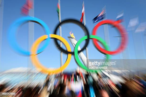 A picture taken on February 13 2014 shows the Olympic Rings and the Olympic flame during the Sochi Winter Olympics in Sochi AFP PHOTO / LOIC VENANCE