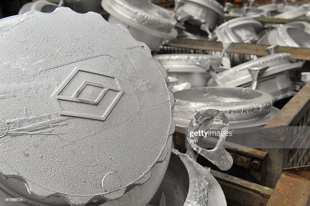A picture taken on February 14, 2013 shows mechanical parts made for French carmaker Renault Trucks stored inside the plant at the DMI foundry in Vaux, as a hundred workers of this plant gone into receivership threaten to blow it up with gas canisters if they don't get compensation for their dismissal.