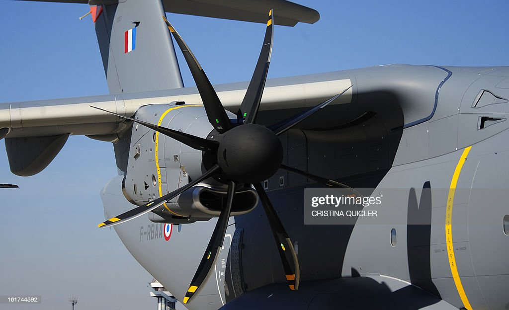 A picture taken on February 15, 2013 shows a propeller of an Airbus Military A400M transport plane at San Pablo-Airbus Military in Sevilla. The four-engine aircraft was designed to replace C-130 Hercules and C-160 Transall cargo planes, and can perform three major roles, according to Airbus, including tactical missions that require the ability to land at 'austere airfields' such as soft or rough strips as short as 750 metres (2,500 feet) with a payload of up to 25 tonnes (55,000 pounds).