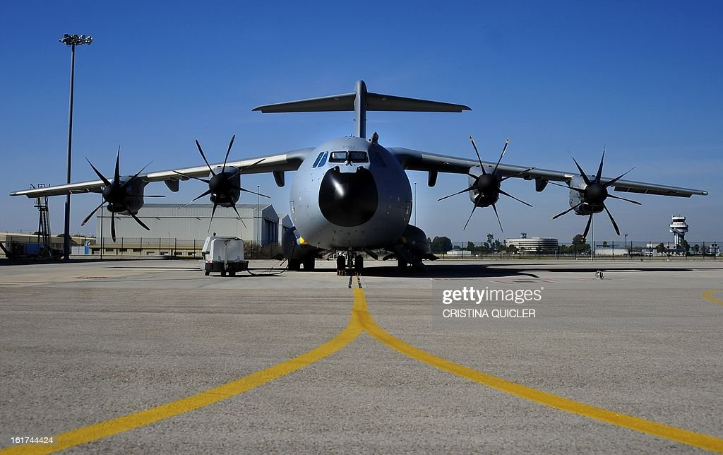 A picture taken on February 15, 2013 shows an Airbus Military A400M transport plane at San Pablo-Airbus Military in Sevilla. The four-engine aircraft was designed to replace C-130 Hercules and C-160 Transall cargo planes, and can perform three major roles, according to Airbus, including tactical missions that require the ability to land at 'austere airfields' such as soft or rough strips as short as 750 metres (2,500 feet) with a payload of up to 25 tonnes (55,000 pounds).