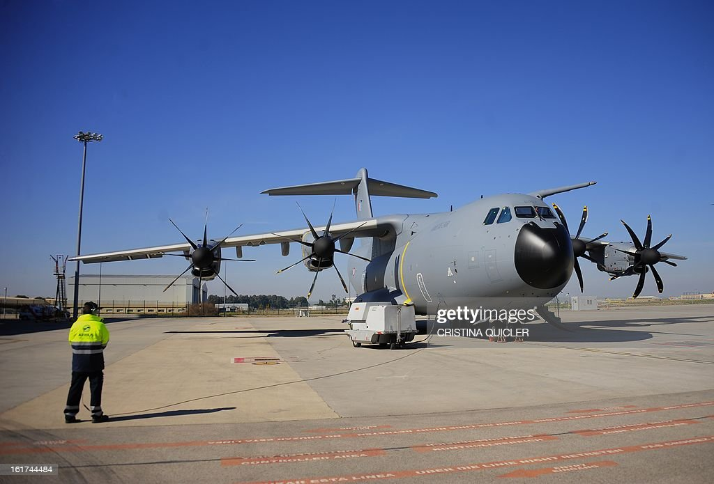 A picture taken on February 15, 2013 shows an Airbus Military A400M transport plane at San Pablo-Airbus Military in Sevilla. The four-engine aircraft was designed to replace C-130 Hercules and C-160 Transall cargo planes, and can perform three major roles, according to Airbus, including tactical missions that require the ability to land at 'austere airfields' such as soft or rough strips as short as 750 metres (2,500 feet) with a payload of up to 25 tonnes (55,000 pounds). AFP PHOTO / CRISTINA QUICLER