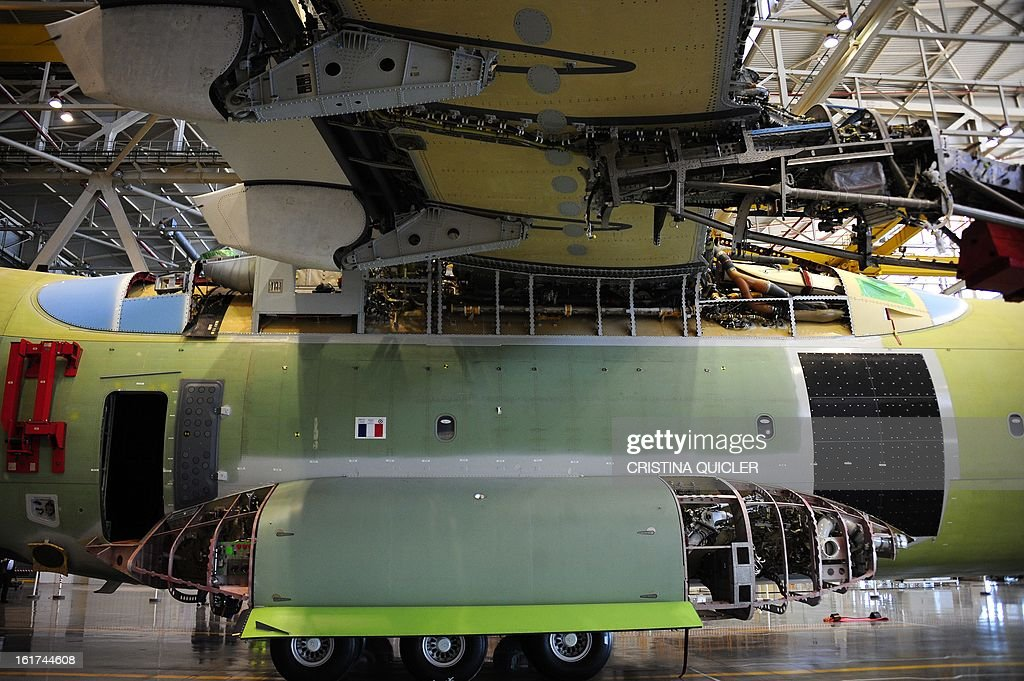 A picture taken on February 15, 2013 shows an Airbus Military A400M transport plane under construction in the factory at San Pablo-Airbus Military in Sevilla. The four-engine aircraft was designed to replace C-130 Hercules and C-160 Transall cargo planes, and can perform three major roles, according to Airbus, including tactical missions that require the ability to land at 'austere airfields' such as soft or rough strips as short as 750 metres (2,500 feet) with a payload of up to 25 tonnes (55,000 pounds).