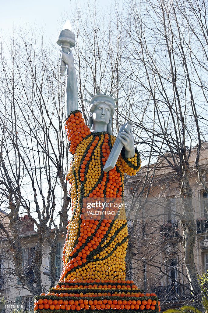 A picture taken on February 15, 2013 shows 'La statue de la Liberte' a sculpture made of oranges and lemons, in Menton on the French Riviera, ahead of the start of the 'Fete du Citron' (lemon carnival). The theme of this 80th edition, running from February 16 until March 6, 2013, is 'Le Tour du monde en 80 jours' (80 days around the world). AFP PHOTO / VALERY HACHE