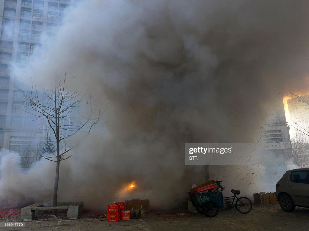 picture taken on February 16, 2013 shows smoke billowing during a firework display to celebrate the Chinese lunar new Year of the Snake in Shenyang, northeast China's Liaoning province. The season is a peak period for fireworks producers, as Chinese traditionally buy the explosives to celebrate the festival, which fell on February 10 this year. CHINA OUT AFP PHOTO