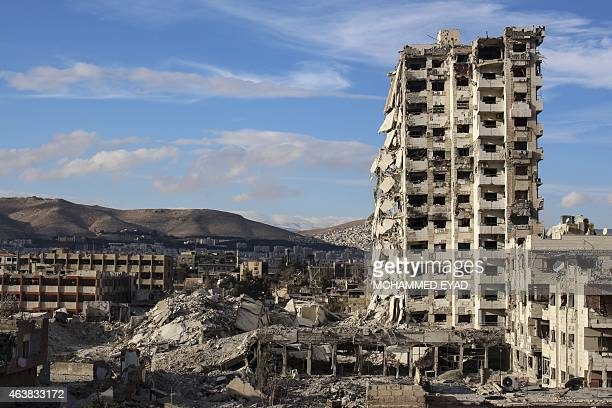 A picture taken on February 16 2015 shows the destroyed 'Teacher's Tower' in Jobar just east Damascus after it was purportedly blown up by Syrian...