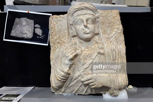 A picture taken on February 16 2017 shows a woman bust which is one of the two funeral reliefs from Palmyra archeological site that will be restored...