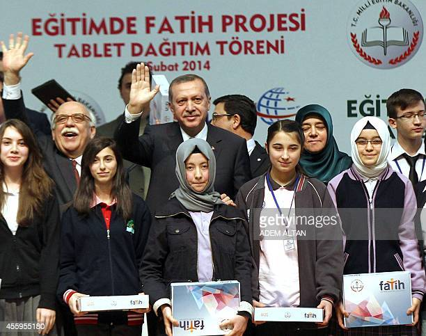 A picture taken on February 17 2014 in Ankara shows then Turkey's Prime Minister now President Recep Tayyip Erdogan Education Minister Nabi Avci...