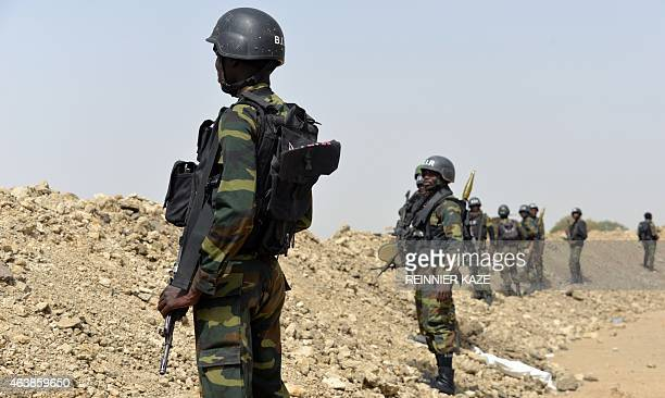 A picture taken on February 17 2015 shows Cameroonian soldiers patrolling in the Cameroonian town of Fotokol on the border with Nigeria after clashes...