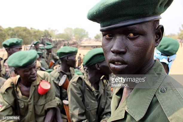 A picture taken on February 18 2016 shows members of the Sudan People's Liberation Army looking on in Juba as they begin withdrawing from the city in...