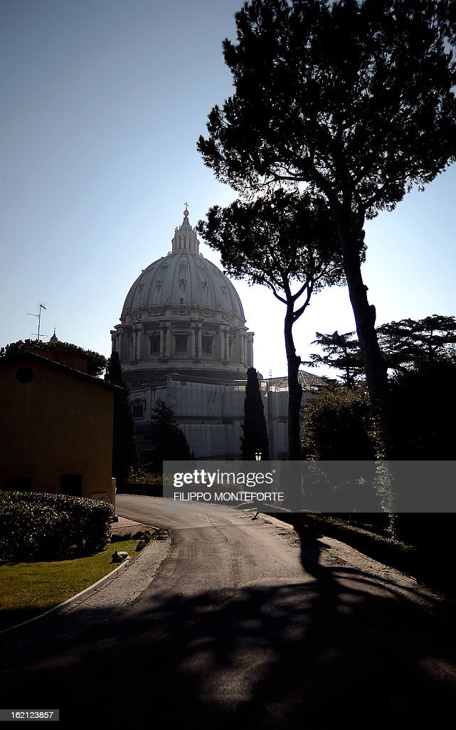 A picture taken on February 19, 2013 shows the St. Peter's Basilica at the Vatican City State. Pope Benedict XVI will be hosted in the convent of Mater Ecclesiae (Mother of the Church) offering him a substantial four-story modern home complete with contemporary chapel, garden and a roof terrace looking out from a rise dominated by the Holy See's TV transmission tower. Pope Benedict XVI began a week-long spiritual retreat out of the public eye on Monday ahead of his resignation on February 28 with the field of candidates to succeed him still wide open. AFP PHOTO/ Filippo MONTEFORTE