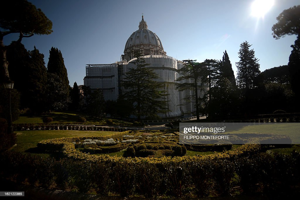 Picture taken on February 19, 2013 shows the St. Peter's Basilica from the gardens at the Vatican City State. Pope Benedict XVI will be hosted in the convent of Mater Ecclesiae (Mother of the Church) offering him a substantial four-story modern home complete with contemporary chapel, garden and a roof terrace looking out from a rise dominated by the Holy See's TV transmission tower. Pope Benedict XVI began a week-long spiritual retreat out of the public eye on Monday ahead of his resignation on February 28 with the field of candidates to succeed him still wide open. AFP PHOTO/ Filippo MONTEFORTE