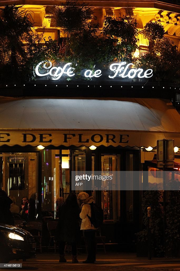 A picture taken on February 19, 2014 shows facade and the sign at night of the French cafe 'Cafe de flore' at the Saint-Germain-des-Pres Square in Paris.