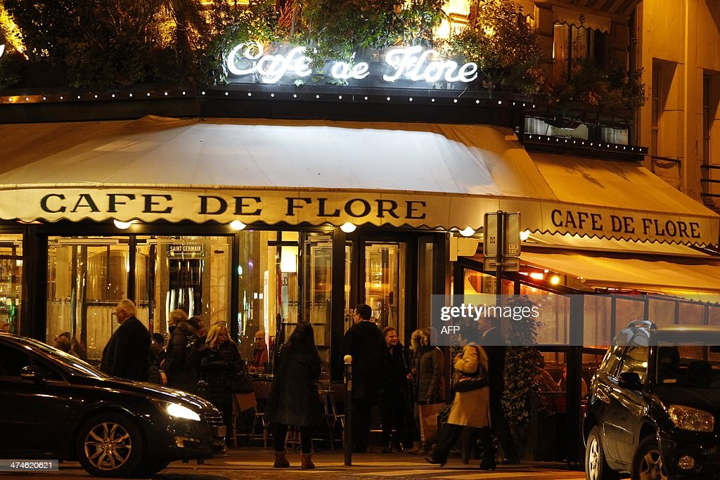 A picture taken on February 19 2014 shows facade and the sign at night of the French cafe 'Cafe de flore' at the SaintGermaindesPres Square in Paris...