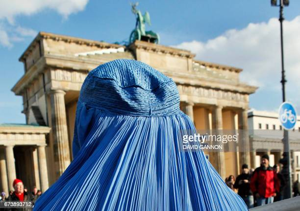 Picture taken on February 20 2010 shows a woman wearing a burka during a demonstration against the German Bundeswehr army's deployment in Afghanistan...