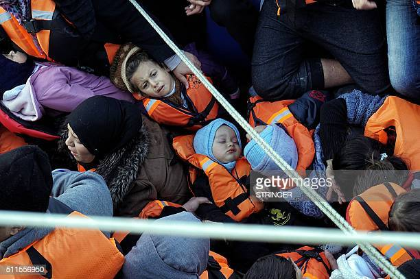 TOPSHOT A picture taken on February 20 2016 shows children among refugees and migrants on a rubber boat on their way from Turkey to the Greek...