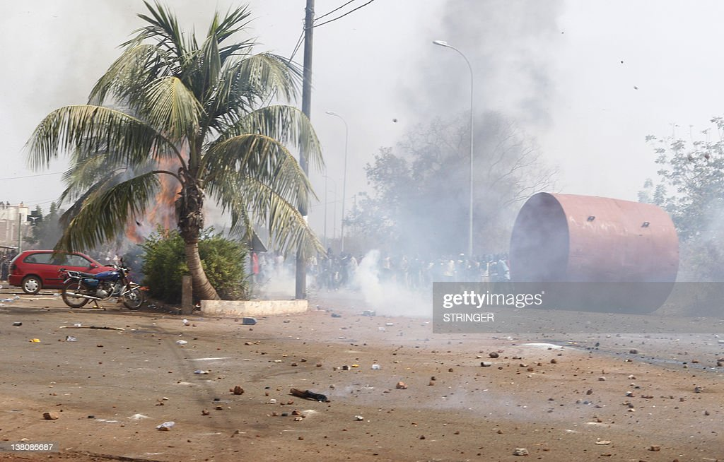 A picture taken on February 22, 2012 shows smoke rising on a street during clashes between relatives and supporters of soldiers fighting rebels Tuareg in the north and security forces during a protest against the 'weak' response to attacks by the rebels, in Bamako on February 2, 2012. Malian President Amadou Toumani Toure has urged citizens not to attack civilian Tuareg, after retaliatory attacks on the community following the resumption of the Tuareg rebellion. Homes and property of Tuareg citizens have been vandalised in the towns of Segou (240 kilometres, 150 miles) from Bamako, and Kati, which is not far from the capital.