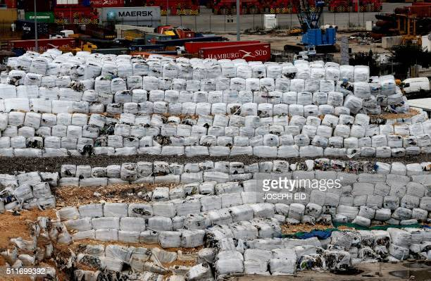 A picture taken on February 22 2016 shows a constructed pile of packed waste in the harbour of the Lebanese capital Beirut Lebanon canceled a plan to...