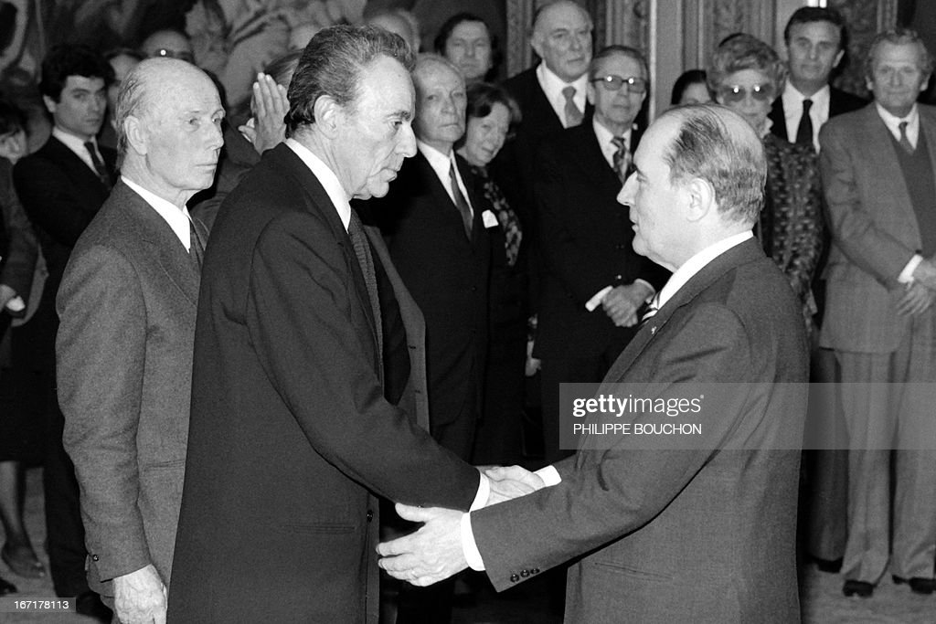 A picture taken on February 23, 1982 at the Elysee palace in Paris shows France's medicine nobel prize Francois Jacob (C) shaking hands with French president Francois Mitterrand during an award ceremony. French biologist Francois Jacob, who won the 1965 Nobel prize for medicine for his research into enzymes, has died at the age of 92, a relative told AFP on April 21, 2013.