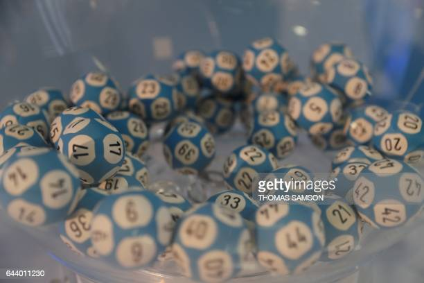 A picture taken on February 23 2017 in Paris shows balls used for the Loto lottery game draw of Française des Jeux the operator of France's national...