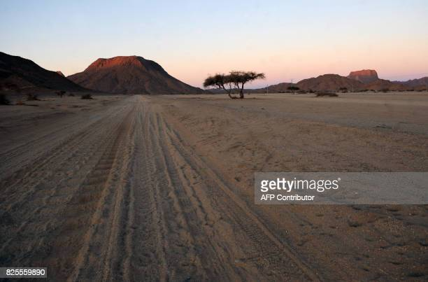 A picture taken on February 24 2010 shows the Tamanrasset desert near the nuclear bomb test site of Tena Fila mountain at Ain Ekra 2000 km south of...