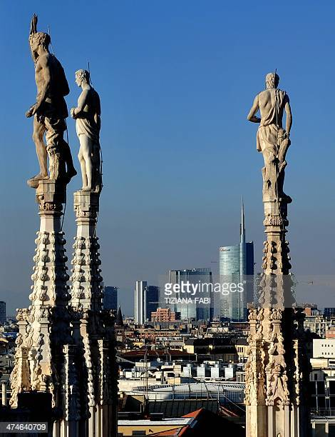 A picture taken on February 24 2014 from the terrace of the Duomo cathedral shows a panoramic view of Milan with buildings of its Porta Nuova...