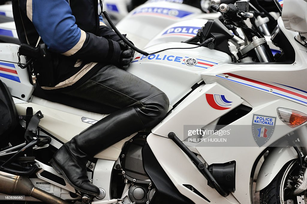 A picture taken on February 25, 2013 shows a French police motorcyclist sitting on a motorcycle in Lille, northern France.