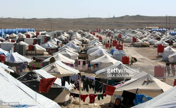 A picture taken on February 25 2017 shows a general view of the tents housing displaced Iraqi refugees who have recently fled from Mosul in a camp in...