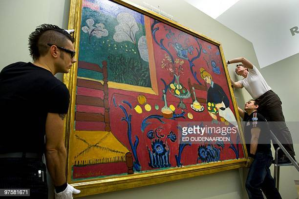 A picture taken on February 26 2010 shows employees as they set up a painting of French painter Henri Matisse 'Red Room' at the Hermitage museum in...