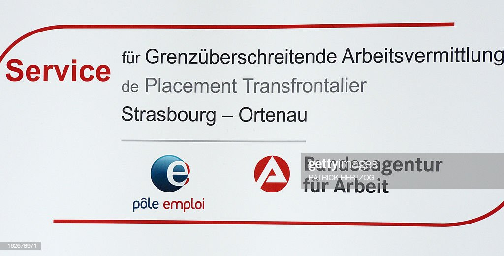 A picture taken on February 26, 2013 in Kehl, south-western Germany shows the logo of the first French-German job center, during its inauguration ceremony. Pole emploi and Agentur fur Arbeit signed a cooperation agreement for the placement of cross-border jobless. AFP PHOTO / PATRICK HERTZOG