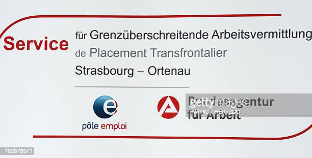 A picture taken on February 26 2013 in Kehl southwestern Germany shows the logo of the first FrenchGerman job center during its inauguration ceremony...
