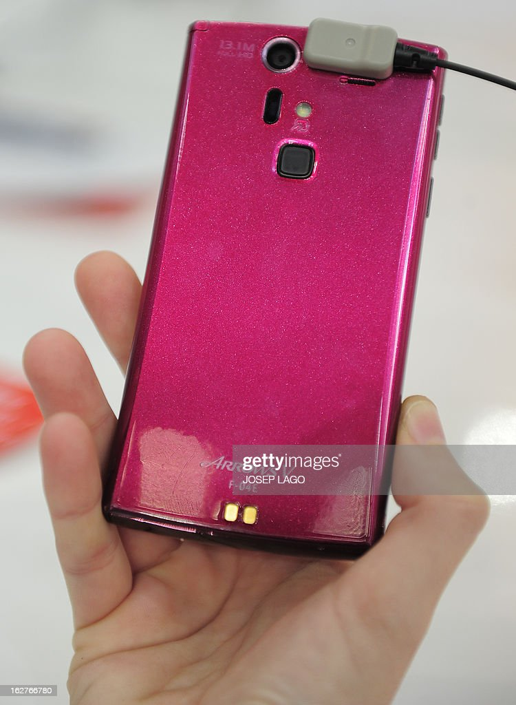 A picture taken on February 26, 2013 shows a new smartphone 'Arrows V F-04e' by Fujitsu with a smart Fingerprint reader at the 2013 Mobile World Congress in Barcelona. The 2013 Mobile World Congress, the world's biggest mobile fair, is held from February 25 to 28 in Barcelona.