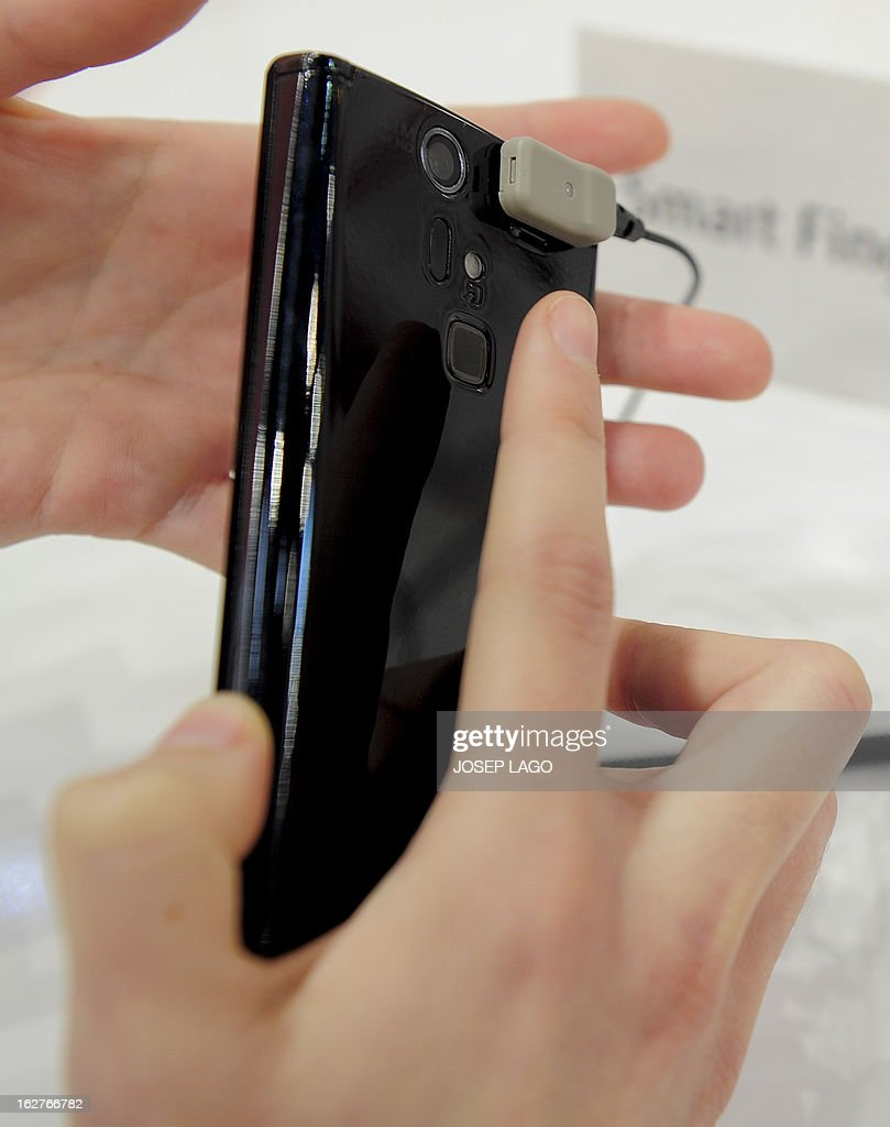 A picture taken on February 26, 2013 shows a new smartphone 'Arrows V F-04e' by Fujitsu with a smart Fingerprint reader at the 2013 Mobile World Congress in Barcelona. The 2013 Mobile World Congress, the world's biggest mobile fair, is held from February 25 to 28 in Barcelona. AFP PHOTO / JOSEP LAGO