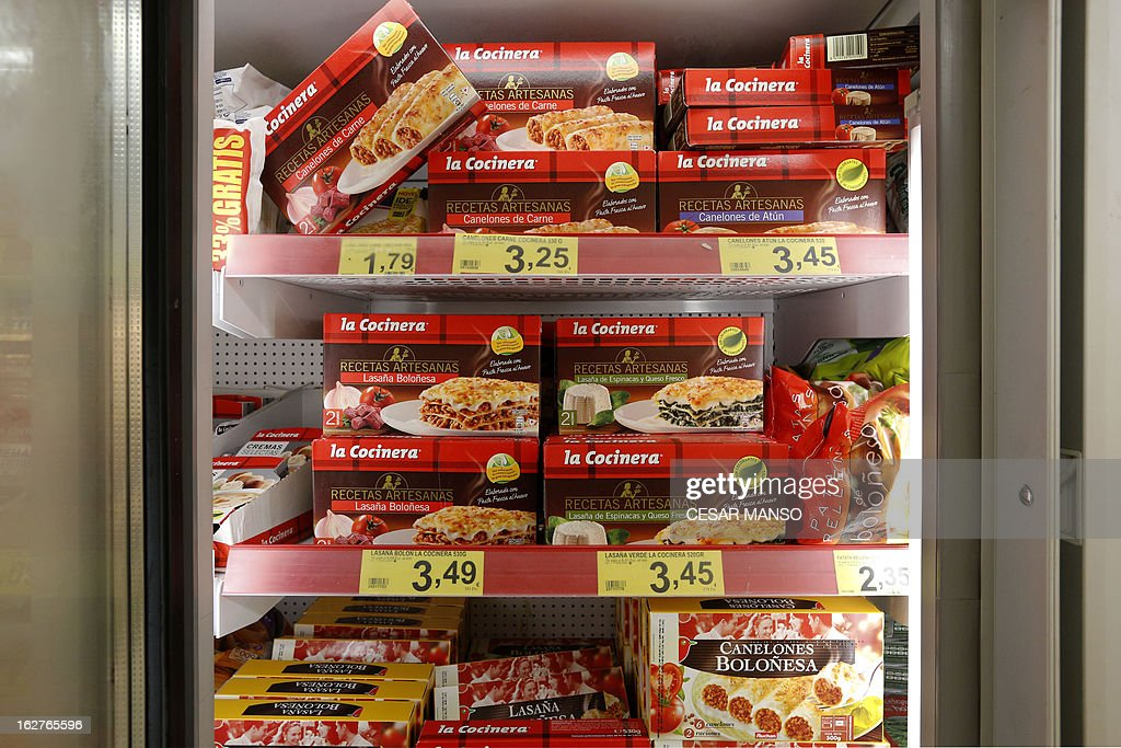 A picture taken on February 26, 2013 shows packages of La Cocinera meat cannelloni (top shelf) on sale in a supermarket in Burgos. Swiss food giant Nestle said on February 25 it had stopped using a Spanish supplier after tests determined there was horse DNA in products supposedly containing pure beef, in the latest development in a Europe-wide food-labelling scandal. Nestle insisted that the six products supplied by Servocar, a company from Casarrubios del Monte (Toledo), that are being removed from shelves in Spain, including Fusilli carne Buitoni Completissimo and Canellonni de carne La Cocinera, did not pose a food safety issue.