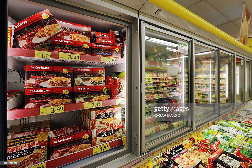 A picture taken on February 26, 2013 shows packages of La Cocinera meat cannelloni (L-top shelf) on sale in a supermarket in Burgos. Swiss food giant Nestle said on February 25 it had stopped using a Spanish supplier after tests determined there was horse DNA in products supposedly containing pure beef, in the latest development in a Europe-wide food-labelling scandal. Nestle insisted that the six products supplied by Servocar, a company from Casarrubios del Monte (Toledo), that are being removed from shelves in Spain, including Fusilli carne Buitoni Completissimo and Canellonni de carne La Cocinera, did not pose a food safety issue.