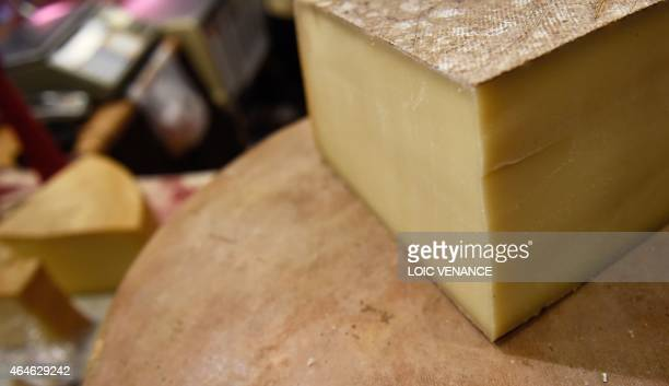 A picture taken on February 26 2015 shows Comte cheeses during the Paris international agricultural fair at the Porte de Versailles exhibition center...