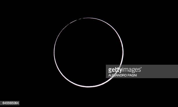 Picture taken on February 26 2017 showing an annular solar eclipse as seen from the Estancia El Muster near Sarmiento Chubut province 1600 km south...