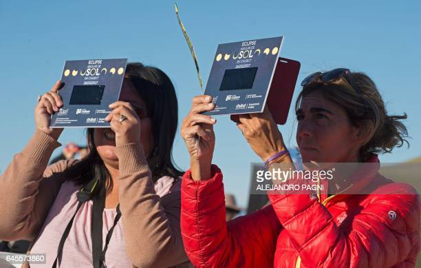 Picture taken on February 26 2017 showing people preparing to see an annular solar eclipse at the Estancia El Muster near Sarmiento Chubut province...