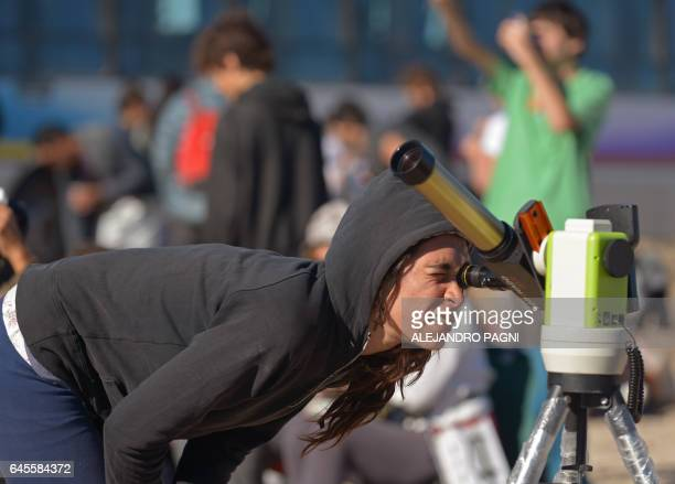 Picture taken on February 26 2017 showing people preparing to watch an annular solar eclipse at the Estancia El Muster near Sarmiento Chubut province...