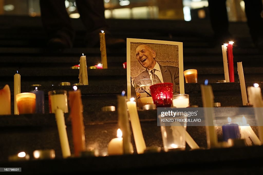 A picture taken on February 27, 2013 in Paris, shows candles sourrounding a portrait of French resistance hero and Holocaust survivor Stephane Hessel who has died today at the age of 95. The career diplomat was already celebrated as one of the last living heroes of the 20th century when, as a nonagenarian, he became the unlikely godfather of youth protest movements such as 'Occupy Wall Street' and Spain's 'Indignados'.