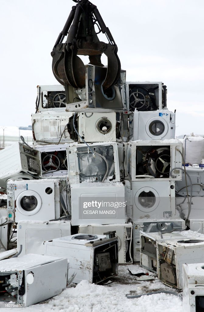 A picture taken on February 27, 2013 shows washing machines being loaded onto a truck at the Company Induraees factory, specialized in electric and electronic waste recycling, in Osorno, northern Spain.