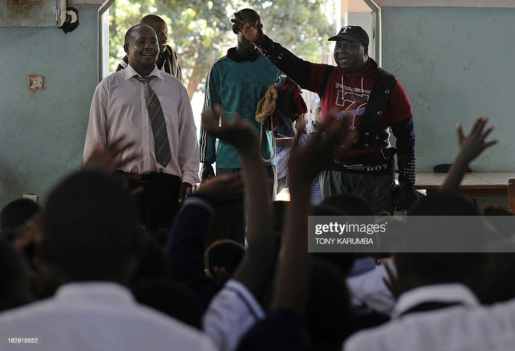 A picture taken on February 28, 2013 shows Conrad Njeru Karukenya, 67, aka 'Tiger-power' receiving applause for his feats of strength during a presentation at Tenri primary school in Kenya's central highlands county of Embu, which is also his place of birth. This living, breathing speed bump is a local legend and has a stomach that is strong enough to withstand a Land Rover running right over him, according to Discovery channel's Quest tv, hosted in the United Kingdom, which in May of last year hosted what has popularly been dubbed a 'superhuman showdown' that featured seemingly regular human beings with incredible abilities in a contest for the title of ultimate Superhuman. Divided into five unifying traits: speed, strength, endurance, brain power and skill five contestants push themselves to the limit in each episode, with Conrad placed second in the strength category, and among five finalists by internationally-acclaimed scientists Dr Heather Berlin, Dr Rahul Jandial and Professor Greg Whyte who will further select the two most impressive individuals to go head to head in the gruelling final showdown. From humble beginnings, the spiritual family man who loves eating organic food and whole grains and has never smoked or indulged in alchohol his entire life says,' I started doing these things as a joke while in school in 1963'. AFP PHOTO /Tony KARUMBA