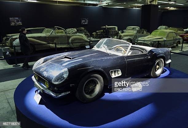 A picture taken on February 3 2015 shows a Ferrari 250 GT SWB California spider from the Baillon collection which belonged to French actor Alain...