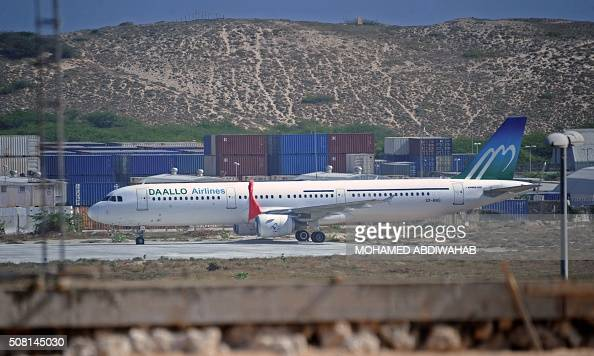 A picture taken on February 3 2016 shows a plane operated by Daallo Airlines after it made an emergency landing on February 2 in Mogadishu following...