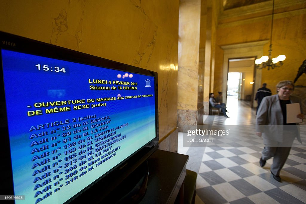 A picture taken on February 4, 2013 at the National Assembly in Paris shows a screen during the debate to allow gay couples to get married and adopt children. Two days before, Members of Parliament voted 249-97 in favour of Article One of the draft law, which redefines marriage as being a contract between two people rather than necessarily between a man and a woman. AFP PHOTO JOEL SAGET