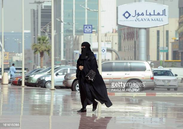 A picture taken on February 4 2013 shows a Saudi woman arriving at the Olaya shopping mall in the Saudi capital of Riyadh AFP PHOTO/FAYEZ NURELDINE