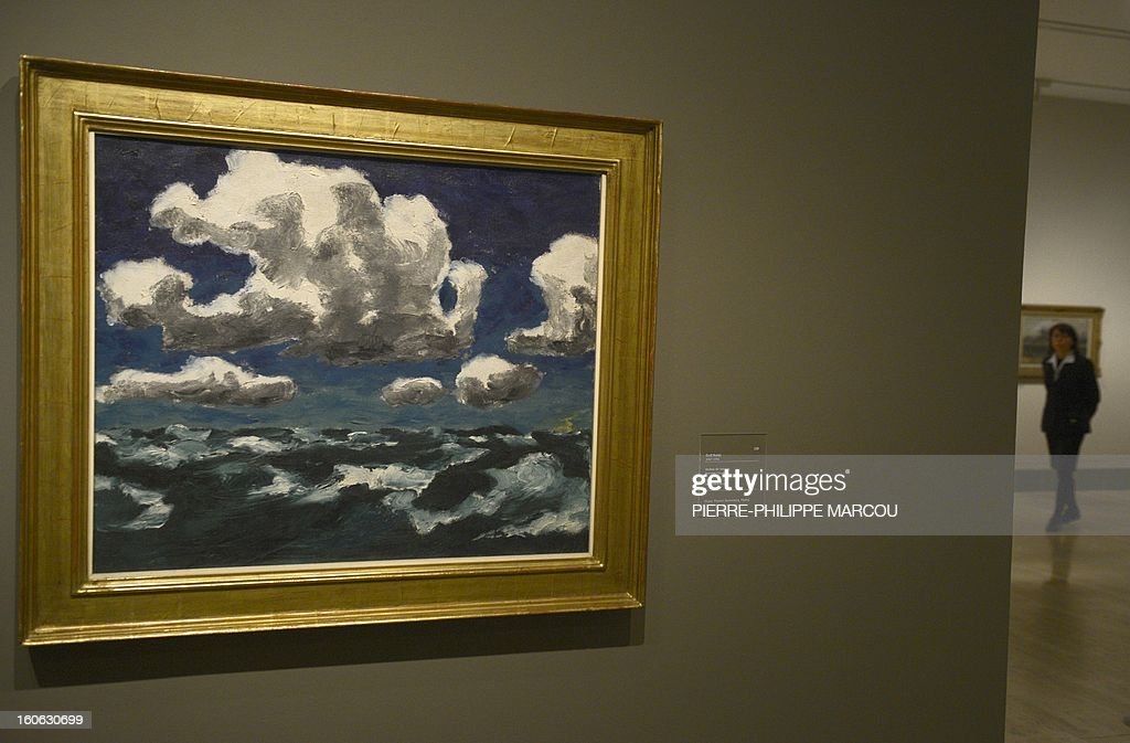 A picture taken on February 4, 2013 shows a work by German painter Emil Nolde entitled 'Summer clouds' at the Thyssen Bornemisza museum in Madrid, during the exhibition 'Impressionism and Open-air Painting. From Corot to Van Gogh'.