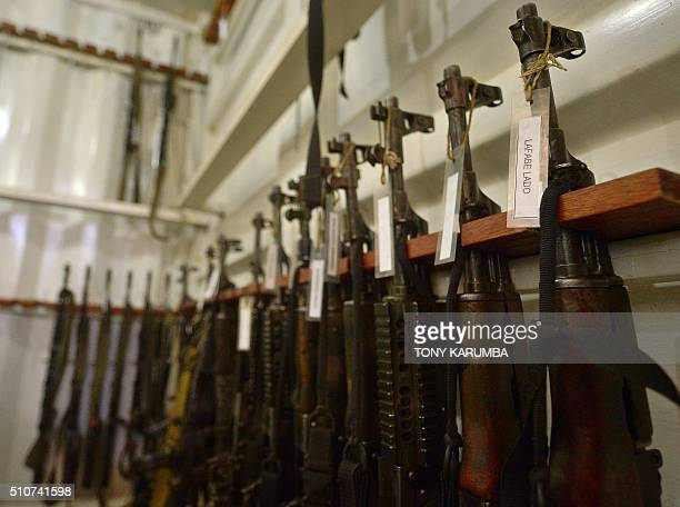 Picture taken on February 4 2016 shows AK47 rifles racked up at the armoury with corresponding nametags prior to their assignment to a team of...