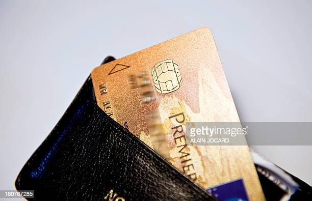 Picture taken on February 5 2013 in Tours shows a Visa Premier credit card in a wallet AFP PHOTO/ ALAIN JOCARD