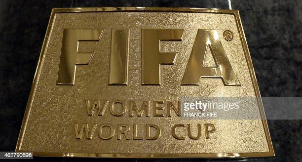 A picture taken on February 5 2015 shows the plaque on the trophy of the FIFA Women's World Cup displayed at the French national football team...