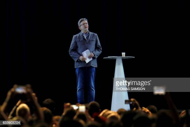 TOPSHOT A picture taken on February 5 2017 in La Plaine Saint Denis northern Paris shows an hologram of French presidential election candidate for...